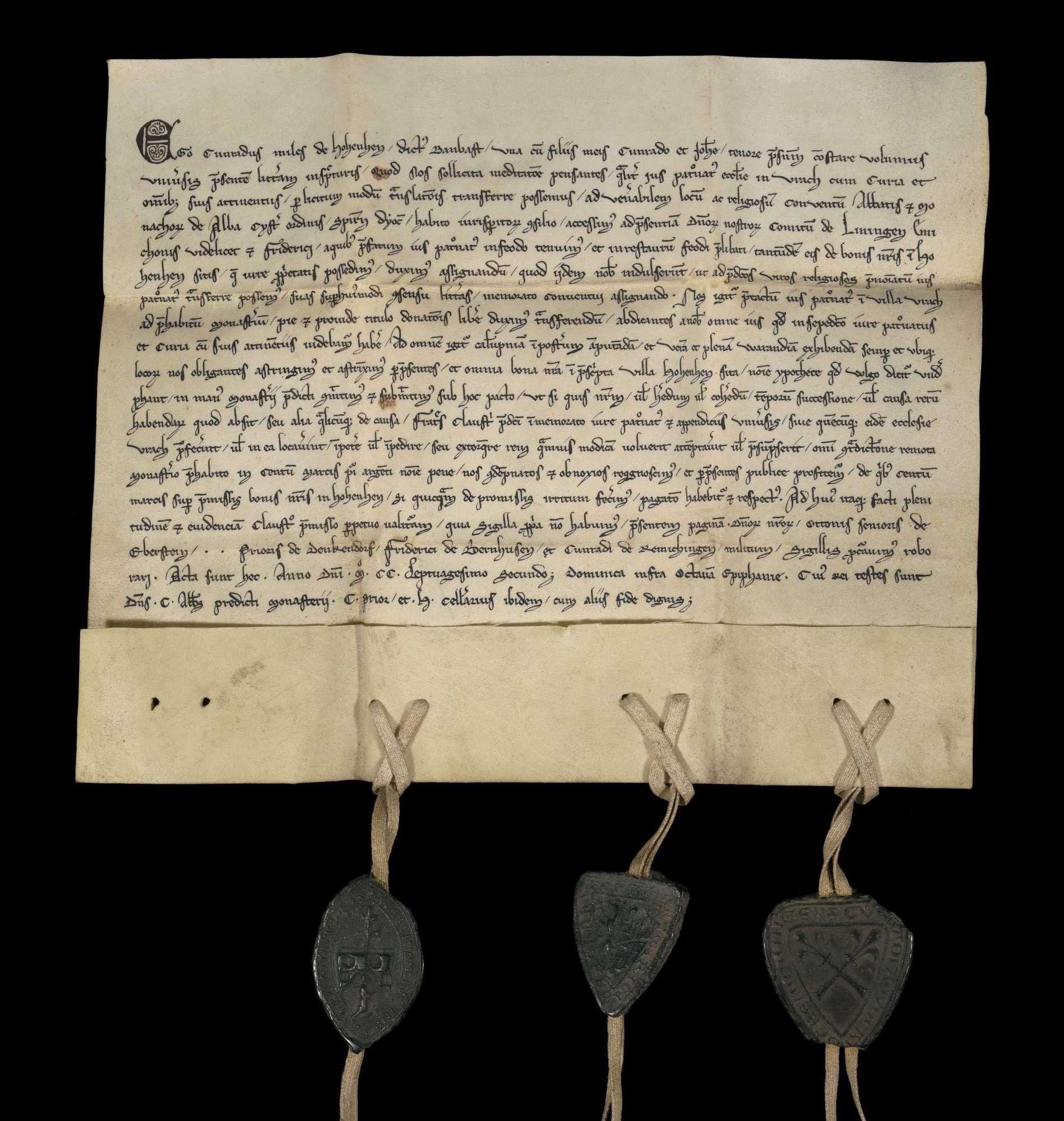 Ritter Konrad von Hohenheim genannt Bombast überträgt mit seinen Söhnen Konrad und Johannes dem Kloster Herrenalb das Patronatrecht der Kirche in Aurich unter Verpfändung seiner Güter in Hohenheim., r