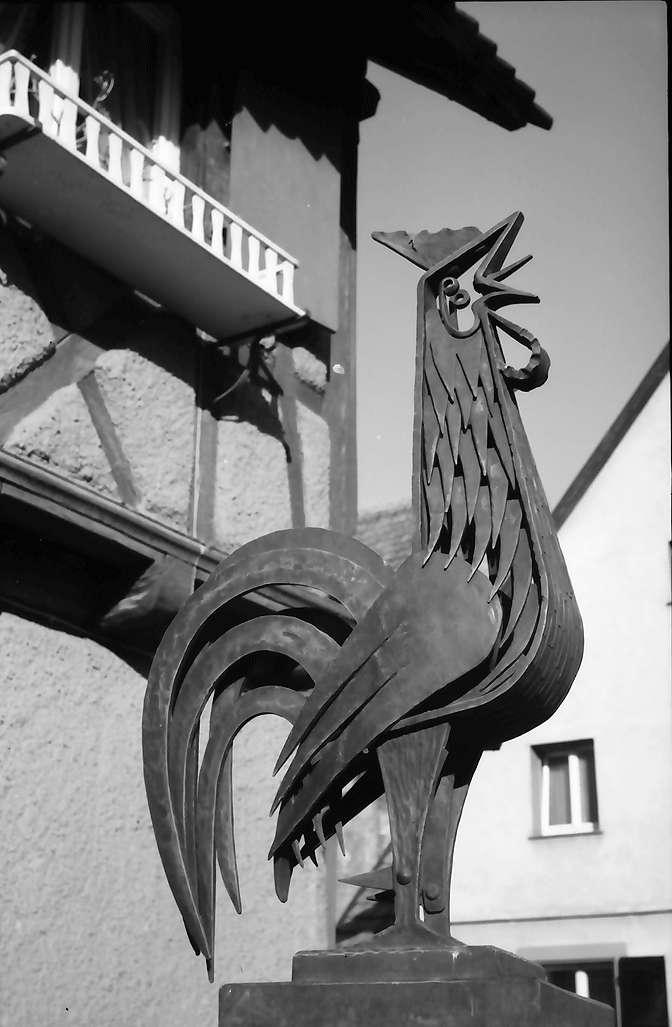 Lörrach, Tumringen: Gockel (Eisen) als Brunnenfigur, Bild 1