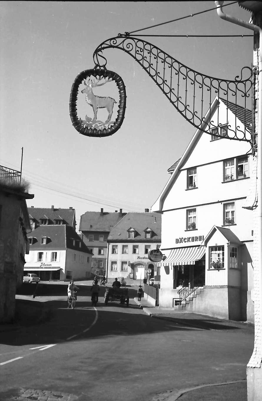 """St. Georgen (Schwarzwald): Gasse mit Aushängeschild """"Hirsch"""", Bild 1"""