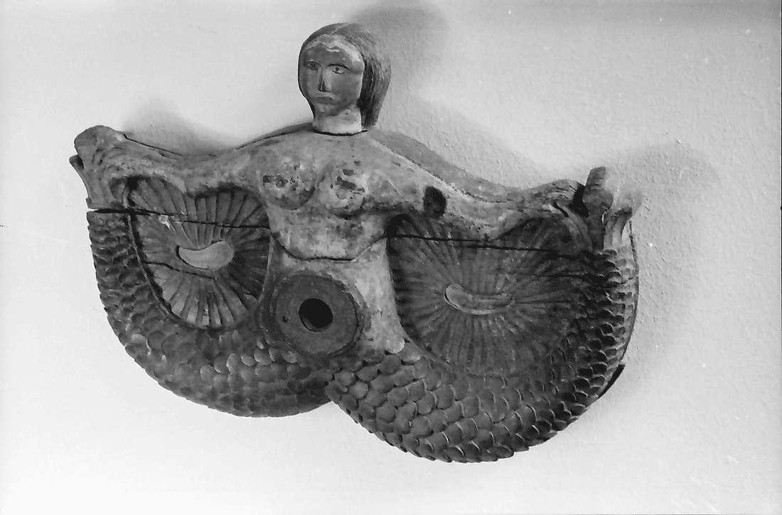 Staufen: Haus Schladerer; Fasshahnverschluss (Figur mit ausgestreckten Armen), Bild 1